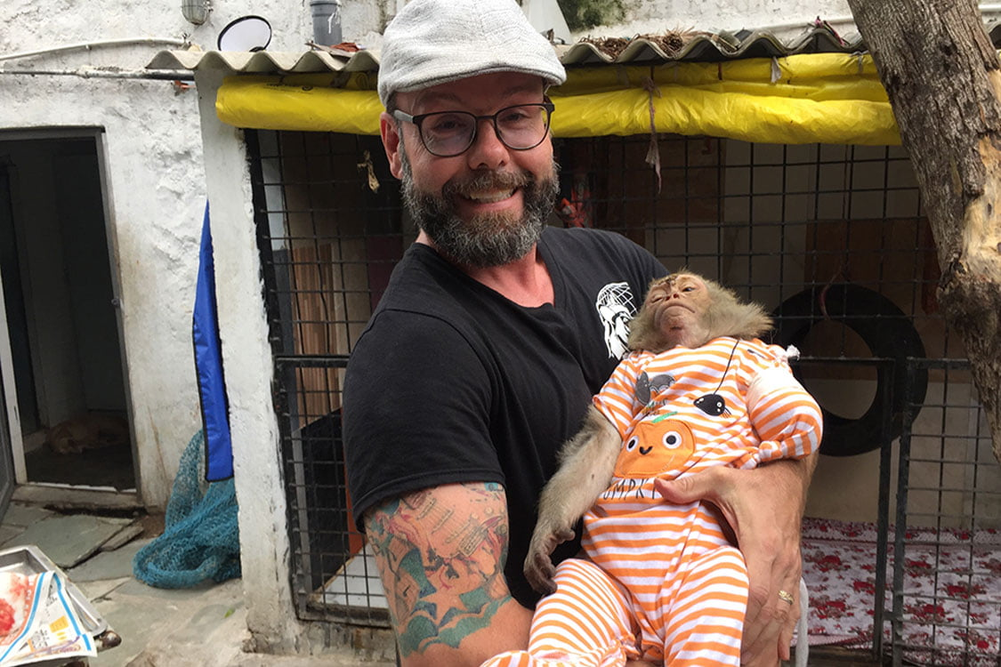 Dr Cliff with sleeping monkey